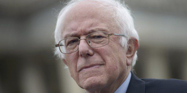 US presidential candidate Senator Bernie Sanders (I-VT) listens to speakers during an event on the Trans Pacific Partnership