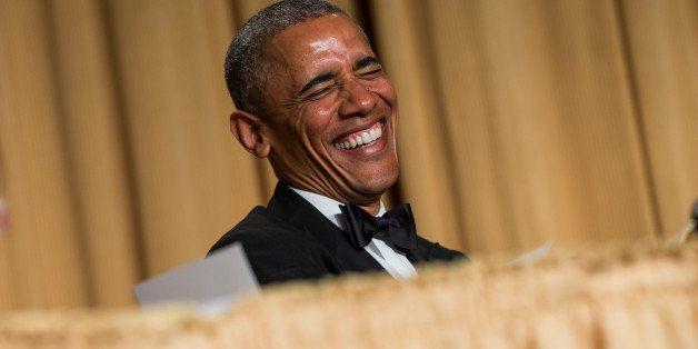 President Barack Obama laughs at a joke during the White House Correspondents' Association dinner at the Washington Hilton on