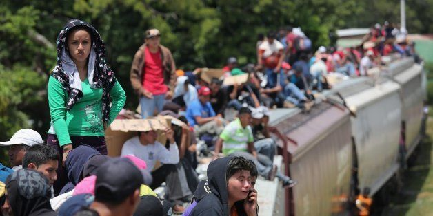 JUCHITAN, MEXICO - AUGUST 06:  Central American immigrants ride north on top of a freight train on August 6, 2013 near Juchit