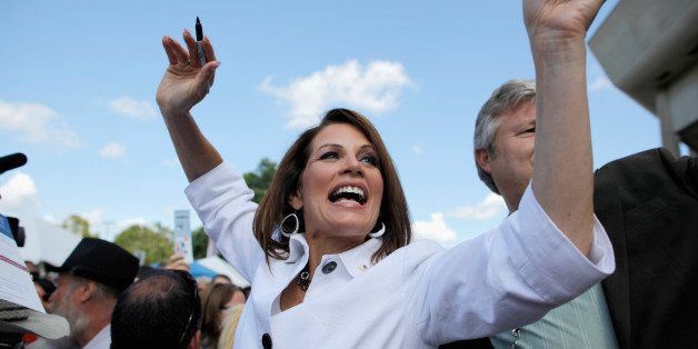 AMES, IA - AUGUST 13:  Republican presidential candidate Rep. Michele Bachmann (R-MN) encourages people to vote for her outsi