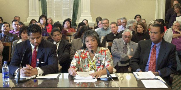 Appearing in an overflow hearing room, Priscilla Hunter,  chairwoman of the  Coyote Valley Band of Pomo Indians, center, was