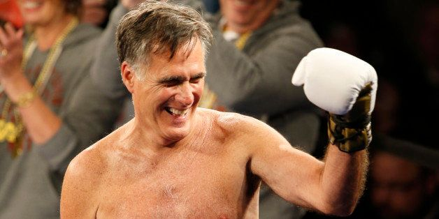 SALT LAKE CITY, UT - MAY 15: Mitt Romney gestures to the crowd during a fight against Evander Holyfield at a charity boxing e