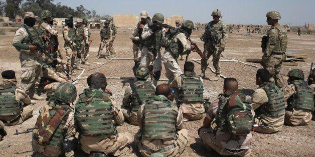 TAJI, IRAQ - APRIL 12:  U.S. Army trainers instruct as Iraqi Army recruits at a military base on April 12, 2015 in Taji, Iraq