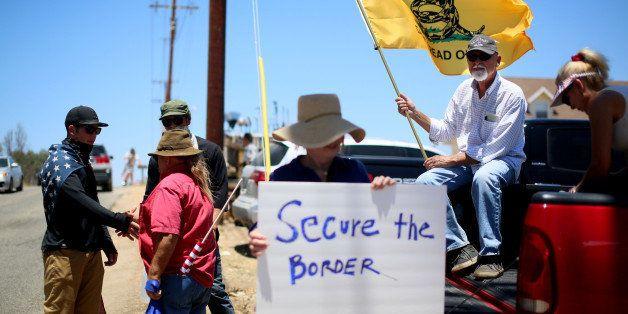 MURRIETA, CA - JULY 7:  Anti-immigration activists protest outside of the U.S. Border Patrol Murrieta Station on July 7, 2014
