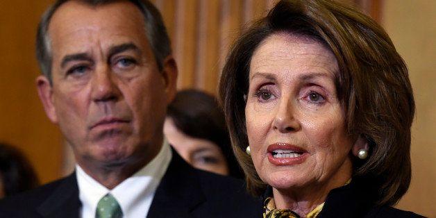 House Speaker John Boehner of Ohio listens at left as House Minority Leader Nancy Pelosi of Calif. speaks on Capitol Hill in