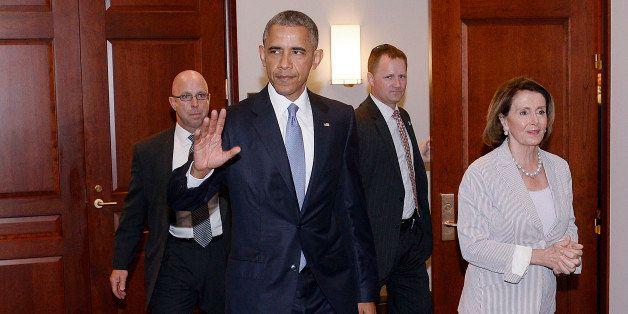 WASHINGTON, DC - JUNE 12:  U.S. President Barack Obama and House Minority Leader Nancy Pelosi leave the Gabriel Zimmerman roo