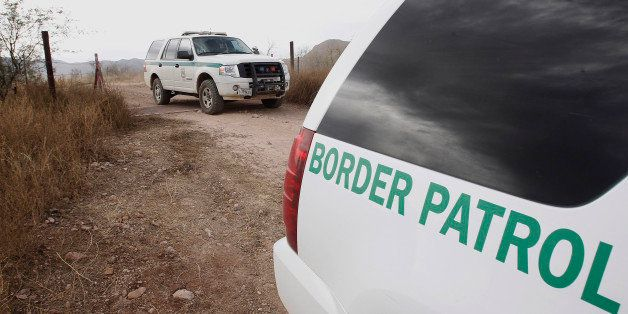FILE - In this Thursday, Dec. 16, 2010 file photo, U.S. Border Patrol vehicles come and go from a checkpoint, as teams of bor