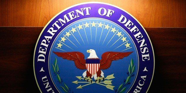 ARLINGTON, VA - SEPTEMBER 27: A light shines on the seal of the Department of Defense during a briefing at the Pentagon, Sept