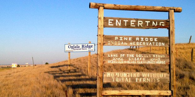 FILE - This Sept. 9, 2012 file photo shows the entrance to the Pine Ridge Indian Reservation in South Dakota, home to the Ogl