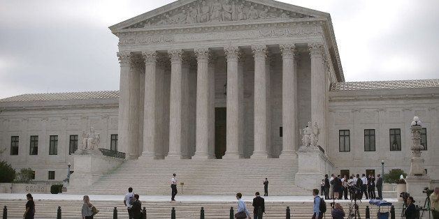 WASHINGTON, DC - JUNE 18:  People gather in front of the Supreme Court Building June 18, 2015 in Washington, DC. This month t