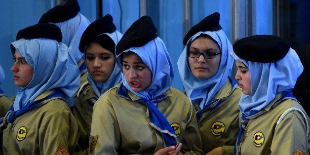 Afghan students look on during a ceremony attended by Afghan President Ashraf Ghani marking the start of the new school year
