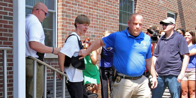 Charleston, S.C., shooting suspect Dylann Storm Roof, second from left, is escorted from the Shelby Police Department in Shel