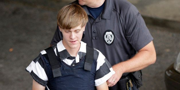 Charleston, S.C., shooting suspect Dylann Storm Roof is escorted from the Cleveland County Courthouse in Shelby, N.C., Thursd