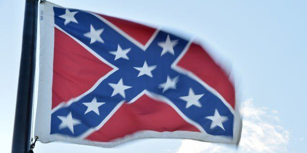 The Confederate flag is seen next to the monument of the victims of the Civil War in Columbia, South Carolina on June 20, 201