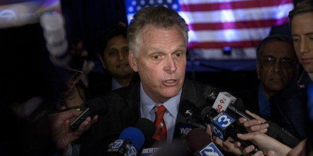 Virginia Governor Terry McAuliffe speaks to reporters on midterm election results during an election night rally November 4,