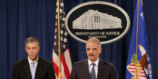 WASHINGTON, DC - MAY 13:  U.S. Attorney General Eric Holder (R) and Education Secretary Arne Duncan hold a news conference at