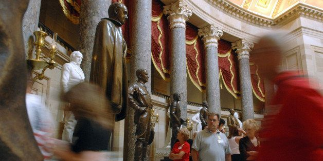 ** ADVANCE FOR MONDAY, JULY 23 ** Tour groups walk through Statuary Hall in the Capitol Friday, July 20, 2007, in Washington.