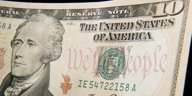 A close-up of the front of the US 10-dollar bill bearing the portrait of Alexander Hamilton, America's first Treasury Secreta