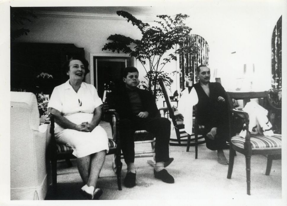 President John F. Kennedy with White House nanny Maud Shaw.