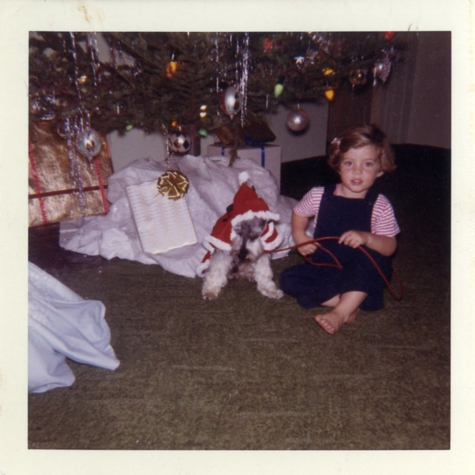 Caroline Kennedy with her dog under the Christmas tree in January 1961.