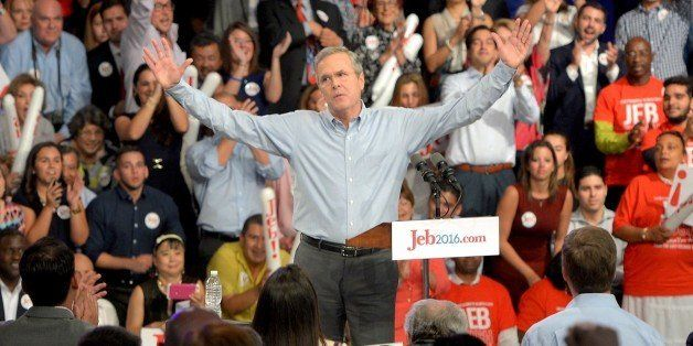 Former Republican Governor of Florida Jeb Bush (C) celebrates after announcing his candidacy for the 2016 Presidential electi