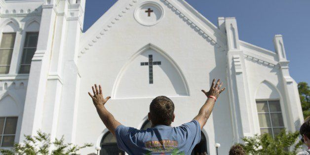 People listen to the Sunday service outside the Emanuel AME Church June 21, 2015 in Charleston, South Carolina.  Large crowds