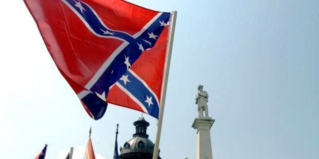 COLUMBIA, SC - JULY 1:  The Confederate flag is waved by supporters in protest of its removal from the Capitol, 01 July 2000