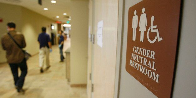 FILE- In this Aug. 23, 2007 file photo, a sign marks the entrance to a gender neutral restroom  at the University of Vermont