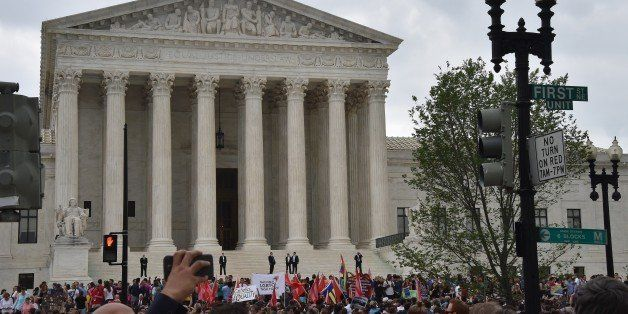 People gather outside the Supreme Court in Washington, DC on June 26, 2015 after its historic decision on gay marriage. The U