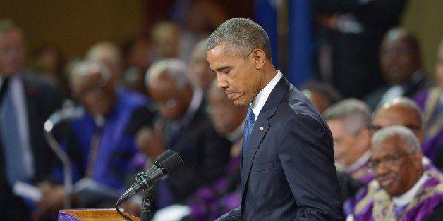 US President Barack Obama delivers the eulogy during the funeral of slain pastor, Rev. and South Carolina State Sen. Clementa