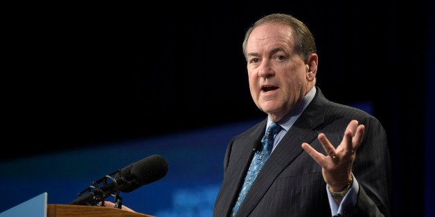 Republican presidential candidate, former Arkansas Gov. Mike Huckabee addresses attendees during Rick Scott's Economic Growth