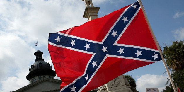 COLUMBIA, SC - JUNE 27:  Demonstrators protest at the South Carolina State House calling for the Confederate flag to remain o