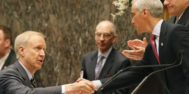 FILE - In this May 6, 2015, file photo, Illinois Gov. Bruce Rauner, left, shakes the hand of Chicago Mayor Rahm Emanuel, righ