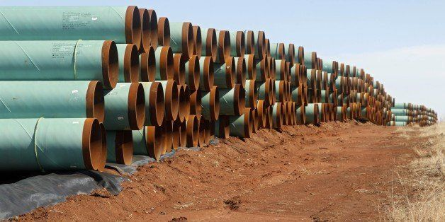 FILE - In this Feb. 1, 2012 file photo, miles of pipe for the stalled Canada-to-Texas Keystone XL pipeline are stacked in a f