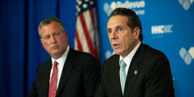 NEW YORK, NY - OCTOBER 23, 2014: Mayor Bill de Blasio of New York City and Governor Andrew Cuomo of New York speak at a press