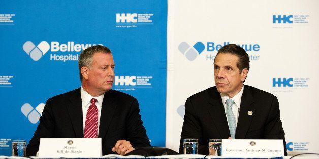 NEW YORK, NY - OCTOBER 23: Mayor Bill de Blasio of New York City and Governor Andrew Cuomo of New York speak at a press confe