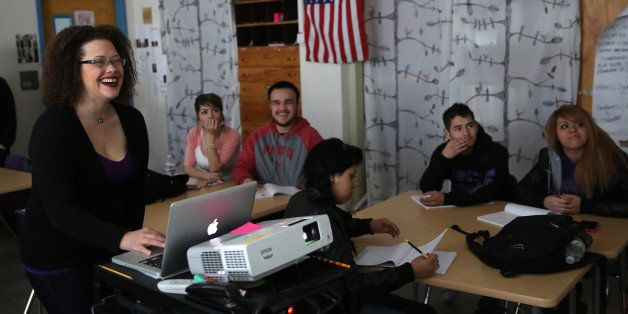 In this Feb. 10, 2014 photo, slam poet and Youth on Record teacher Suzy Q. Smith smiles as she projects a video for students