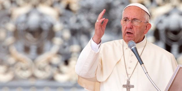 Pope Francis delivers his blessing at the end of his weekly general audience, in St. Peter's Square, at the Vatican, Wednesda