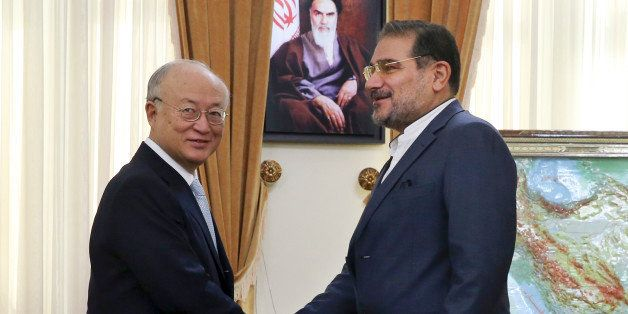 Secretary of Iran's Supreme National Security Council Ali Shamkhani, right, welcomes Director General of the International At
