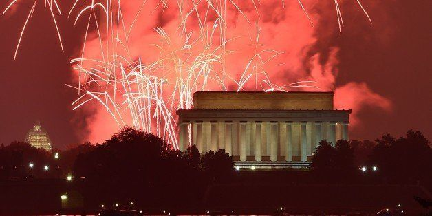 Fireworks explode over the Lincoln Memorial, the Washington Monument and the US Capitol in celebration of Independence Day in