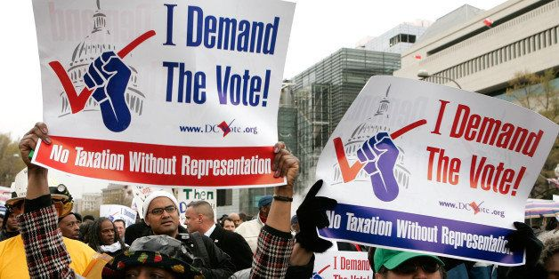 WASHINGTON - APRIL 16:  Demonstrators hold posters during a march to ask for a voting representation for the nation's capital