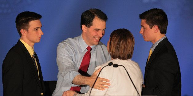 WAUKESHA, WI - JUNE 05:  Wisconsin Governor Scott Walker greets his wife Tonette and sons Alex and Matt at an election-night