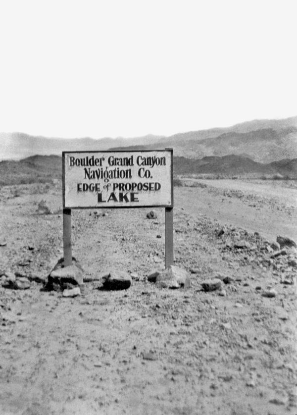 Sign showing where the edge of Lake Meade will be upon completion of Boulder Dam, Nevada, late 1920s. It was renamed Hoover D