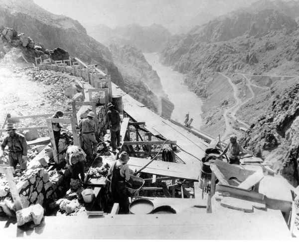 Construction continues Jan. 9, 1932 as workers construct the retaining wall that gives support to the road leading over the t