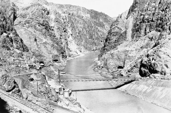This general view of Black Canyon on the Colorado River, looking upstream toward the site of Hoover Dam, shows a temporary st