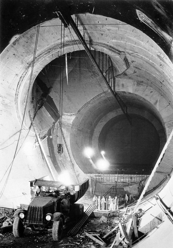 Inside of diversion tunnel no. 3, on the boulder dam project, showing concreting operations, July 9, 1934. The intersection o