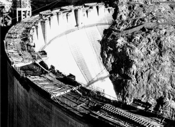 More than 700 feet over the Colorado River bed, workers put the finishing touches on the Hoover Dam on Aug. 12, 1931.