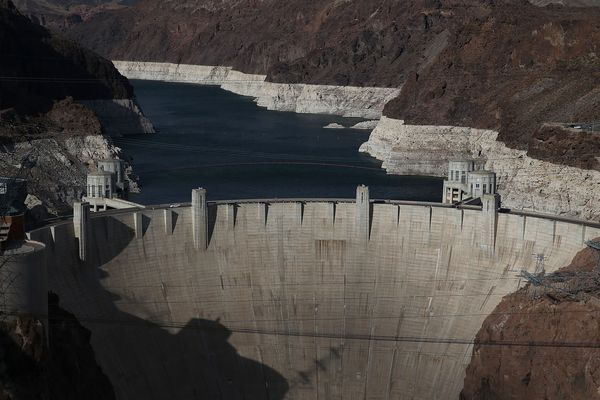 A tall bleached 'bathtub ring' is visible behind the Hoover Dam on May 12, 2015 in Lake Mead National Recreation Area, Arizon
