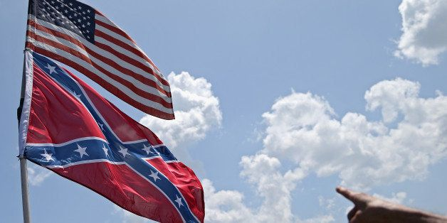 DAYTONA BEACH, FL - JULY 03: An American and a Confederate flag are seen during practice for the NASCAR Sprint Cup Series Cok