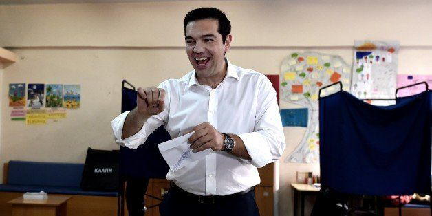 Greek Prime Minister Alexis Tsipras prepares to vote during the Greek referendum in Athens on July 5, 2015. Greek voters head